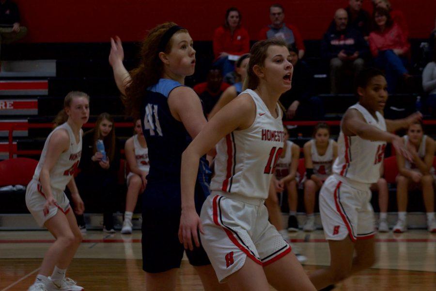 Grace Mueller, senior, looks for the ball as she plays defense.