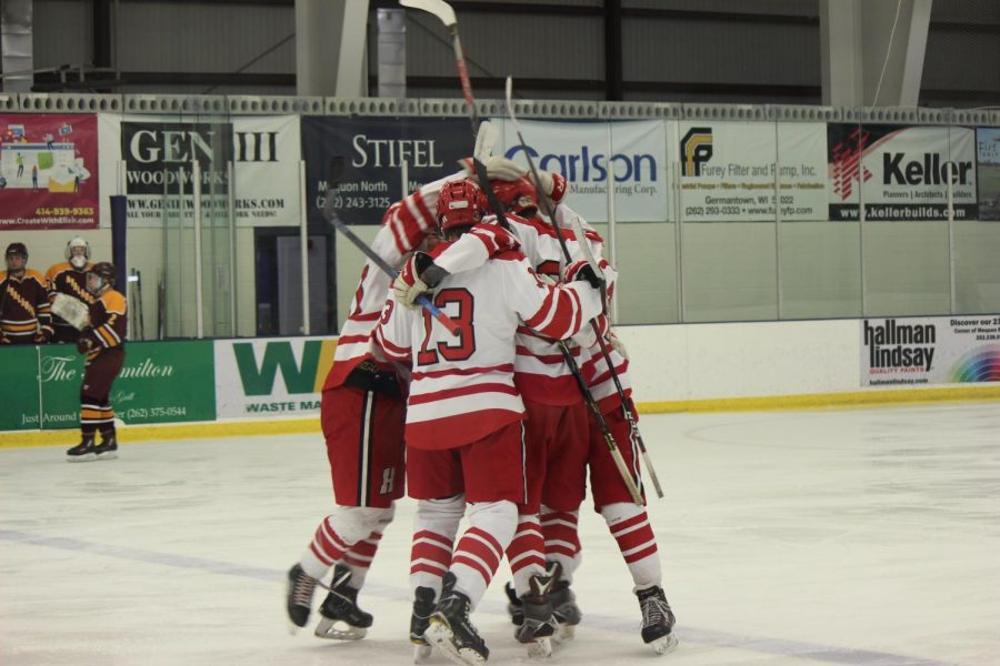 The+boys+celebrate+after+Willy+Quale%2C+senior%2C+scores+the+first+goal+of+the+game.