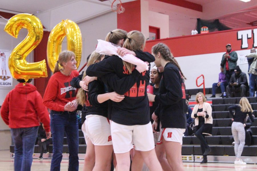 The team gives the seniors a big hug after listening to the speeches written for them.