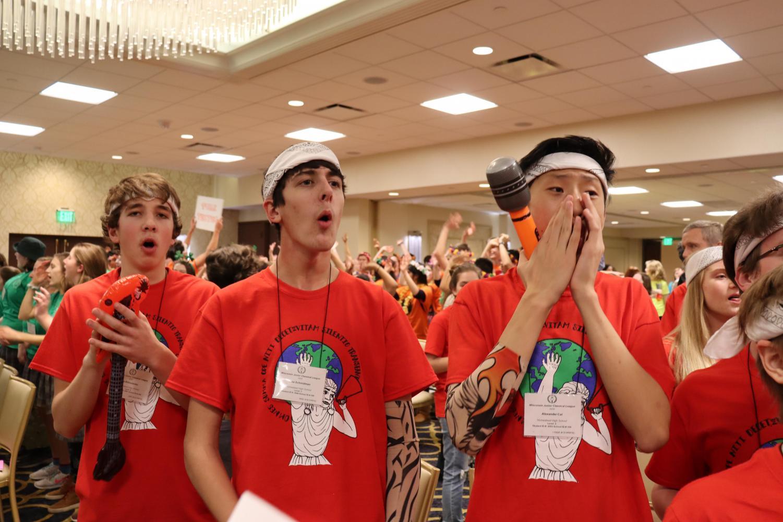 Ilia Mikhailenko, freshman, Jake Schmidman, and Alexander Cai, sophomores, show school spirit at the Wisconsin Junior Classical League convention.