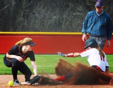 Karlee Braun slides into the plate in hope for a victory for her team.