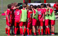 The Homestead boys varsity soccer team huddle before a big match against Marquette during the 2019 season.