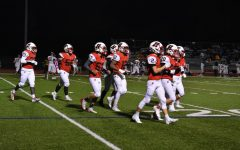 Homestead's defense runs off the field during the first quarter of Friday's football game.