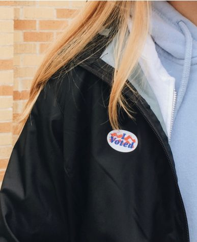 Paige Wallner, senior, shows off her sticker after she voted on Oct. 20.