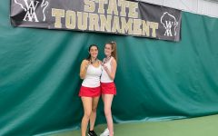 Kate Wade, senior, and Ellie Sprinkmann, junior, pose with their medals at state.