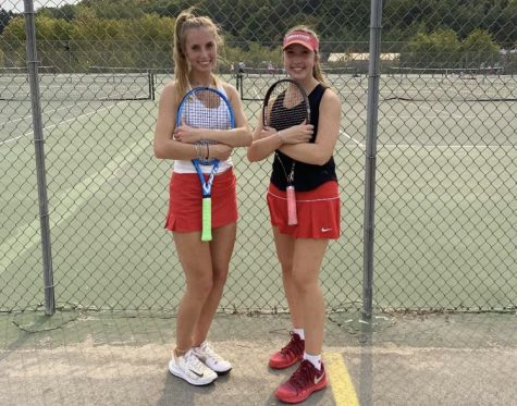 Andrea Schwalbach (right) posing with her doubles partner, Olivia Kowaleski (left), after a winning match during the 2020-2021 season.