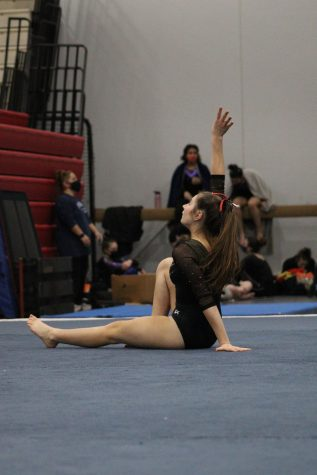Ariana Halaska, senior, poses during her floor performance.