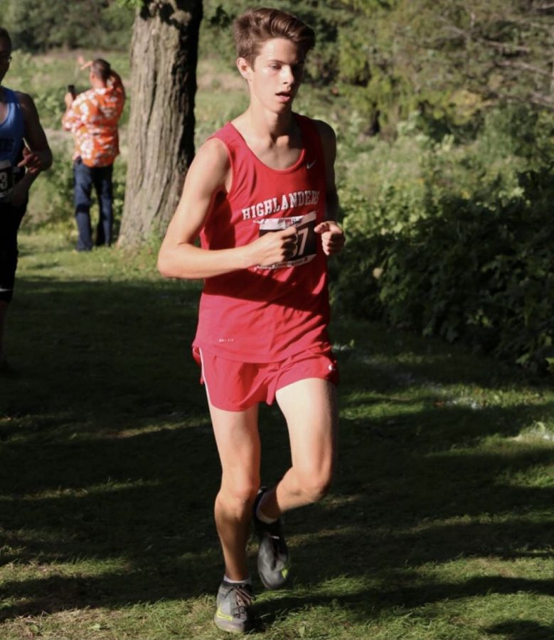 Nathan Gruenwald runs at a cross country meet during the 2019-2020 season last year at Homestead.