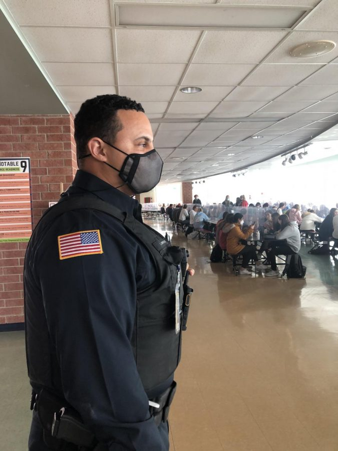 Officer Lewis Johnson surveys the lunchroom. Photo by Annie Brown