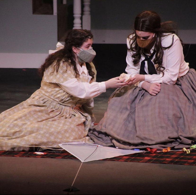 Chloe Diamond, junior, and Katrina Liberman, senior, portray their characters Jo and Beth during a scene.