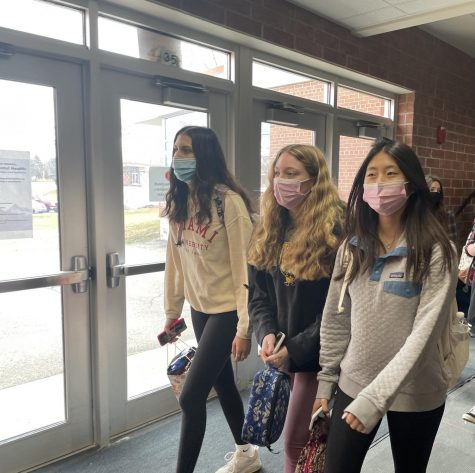 Juniors,Livi Patel, Reilly West and Stella Kim make their way their 3rd hour class in a recently reopened 2-way hallway.