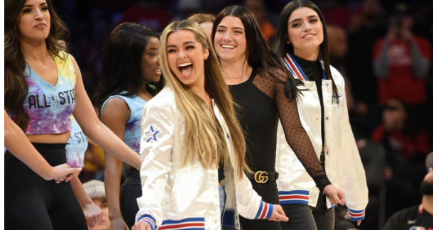 Pictured above in black, Charli D'amelio along with other TikTokers perform at halftime at the 2020 NBA All Star Celebrity Game due to their successes on the app.