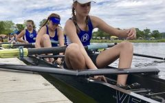 Cate Hering, junior, prepares to race with her teammates at a competition prior to COVID-19.