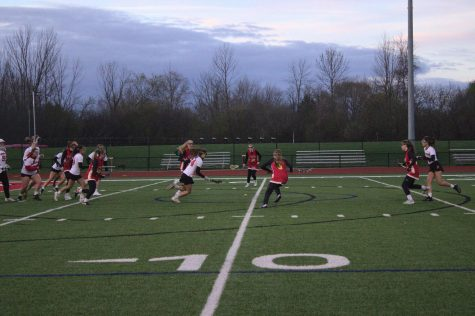 Theadora Krueger, senior, chases after a loose ball on the field.