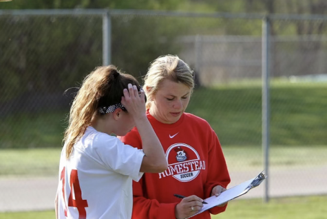 Denk took over as the head coach for the girl
