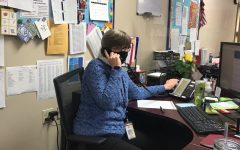 Linda Dean in the attendance office operates the school phones for daily announcements.