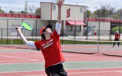 Zach Sprinkmann, senior, serves the ball to his teammate before the tournament.