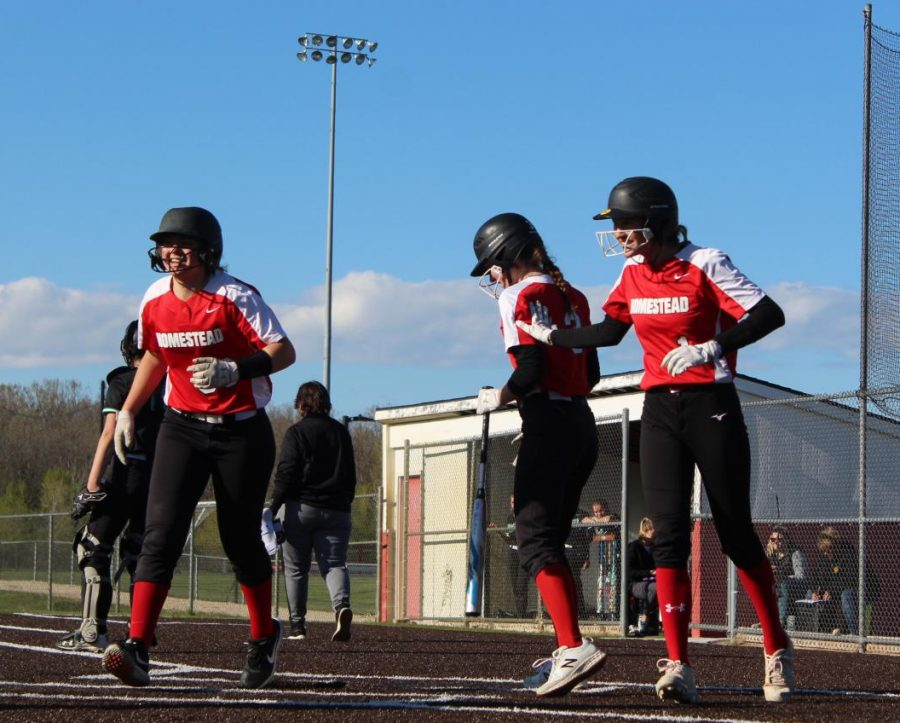 Bella Magee, junior, and her teammates laugh mid-game while competing against Port Washington.