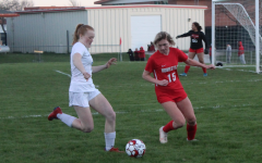Caitlin O'Brien, freshman,  fights for the soccer ball at the girls first game of the season.