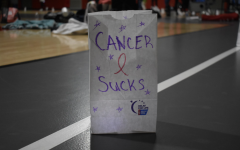 Students designed bags and place them around the track for the luminaria ceremony.