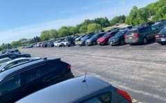 The red lot is one of six lots students can park in---but it comes with a price.