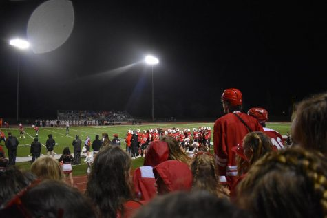 The student section watches the homecoming game intently.